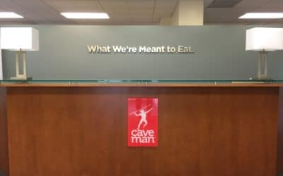 Lobby sign in Lafayette for Caveman Foods