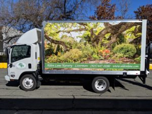 A box truck with marketing graphic on the side